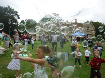kids chasing lots of bubbles