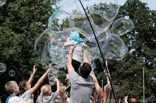 holding child up into a bubble